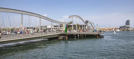 rambla: BARCELONA, SPAIN - JULY 4, 2016: Marina Port Vell and the Rambla del Mar in Barcelona. Ramblas del Mar are a wooden bridge built in 1994.