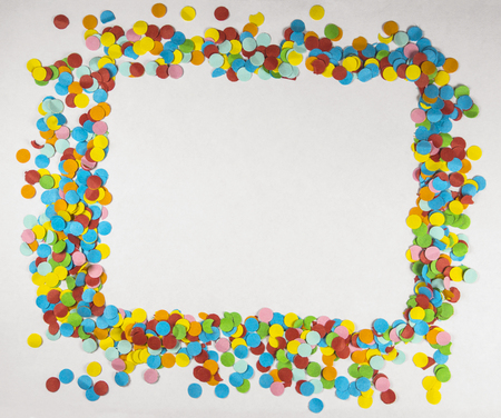variable: Festive paper circular colorful confetti frame closeup