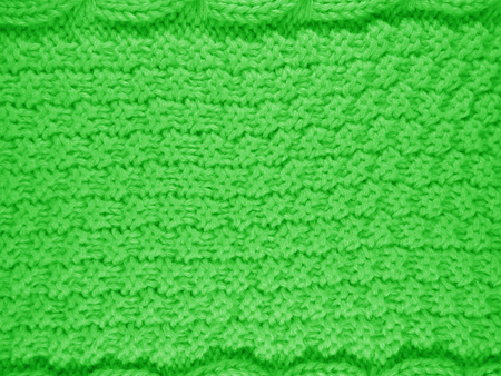 Close up of woolen knitted texture - Green
