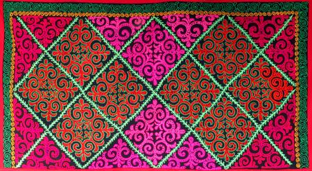 Kazakh felt carpet with ornament inside the yurt in Almaty, Kazakhstan