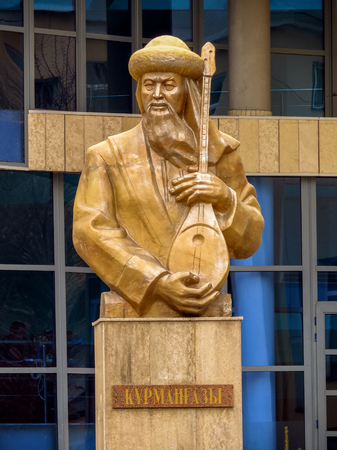 conservatory: ALMATY, KAZAKHSTAN - MARCH 26, 2017: Bust of Kurmangazy opposite the Kazakh National Conservatory in Almaty, Kazakhstan. Was a Kazkh composer, instrumentalist, and folk artist. Editorial