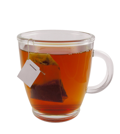 Glass teacup with teabag, isolated on white with Clipping Path Stock Photo