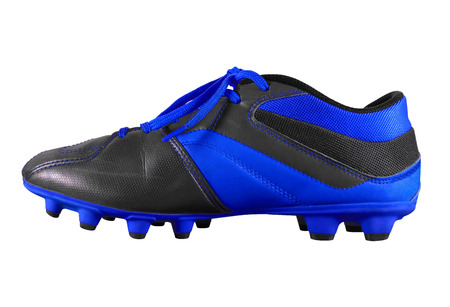 Dark blue football boots isolated on white