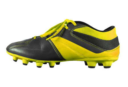 Yellow football boots isolated on white