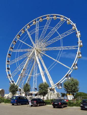Rimini, Italy - June 21, 2017: Beautiful Ferris wheel on the beach of Rimini, Italy