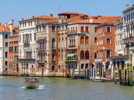 venice: Venice, Italy - June 20, 2017: View from water street to old buildings in Venice, Italy
