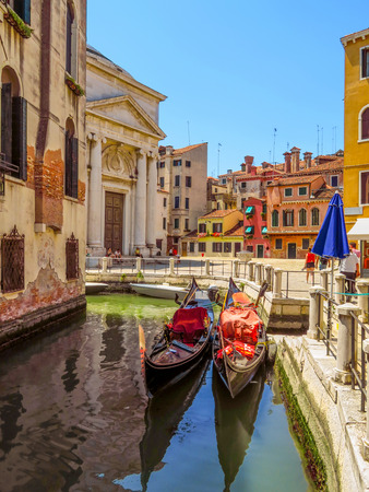 venice: Venice, Italy - June 20, 2017: View from water canal to old buildings in Venice, Italy