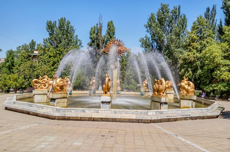 Almaty, Kazakhstan - August 5, 2017: Fountain Oriental calendar near the building of the Academy of Sciences of the Republic of Kazakhstan