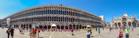 thousands: Venice, Italy - June 20, 2017: Panoramic view of a San Marco square in Venice, Italy. Thousands of tourists every month visit St Marks Square.