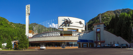 Almaty, Kazakhstan - July 21, 2014: Panoramic view of famous skating rink Medeo and mountains at the background in Almaty, Kazakhstan