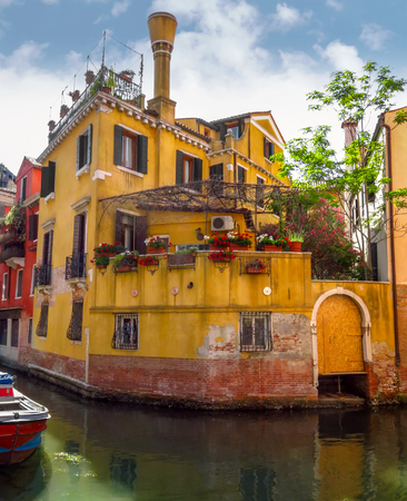 Venice, Italy - June 20, 2017: View from water canal to old buildings in Venice, Italy