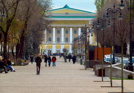 Almaty, Kazakhstan - November 15, 2017: Promenade along Panfilov Street overlooking the Kazakh Opera and Ballet Theater. Unidentified people are walking along the street. Stock Photo - 89896797