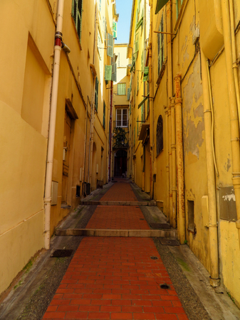 Medieval street in the old town of Menton, France. Menton is a small seaside town on the French Riviera. 版權商用圖片