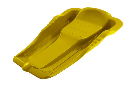 Yellow plastic sled isolated on a white background with clipping path. Banque d'images