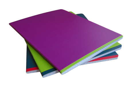 Stack of colorful notebooks isolated on a white. Clipping path included. Standard-Bild