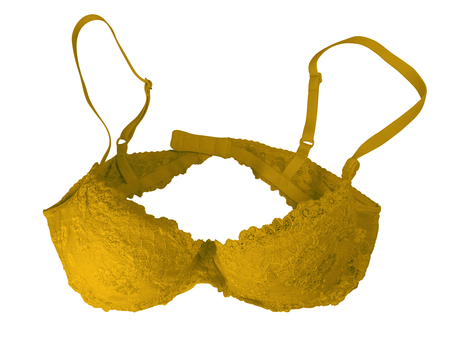 Yellow lace brassiere isolated on white. Clipping Path included.