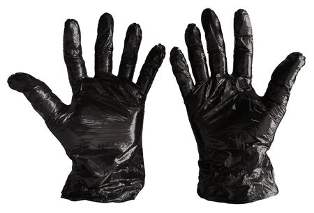 Disposable black plastic gloves isolated on white. Clipping path included. Stockfoto