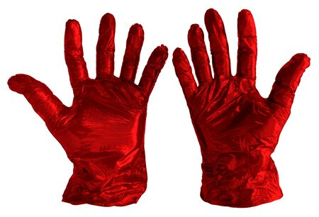 Disposable red plastic gloves isolated on white. Clipping path included.