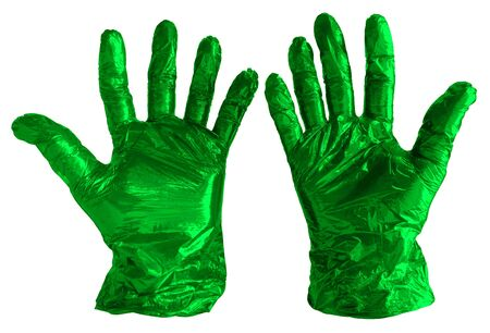 Disposable green plastic gloves isolated on white. Clipping path included.