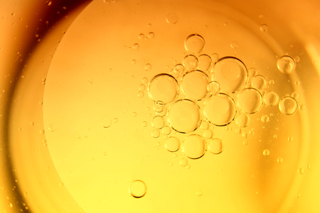 Yellow bubbles and drops of oil background, kitchen pattern, orange beverage background.
