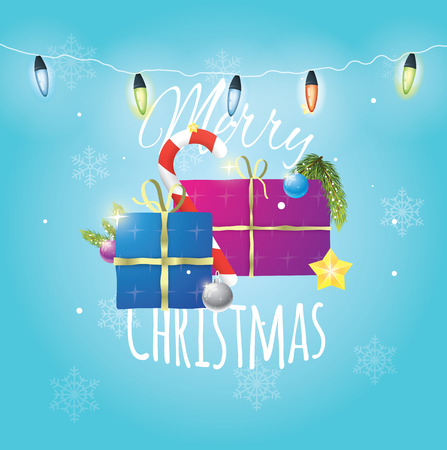 Beautiful composition of christmas items on blue snowy background with christmas lights.