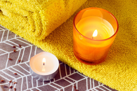 Spa composition with candles and towel. 版權商用圖片