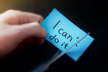 I can do it / I can't do it. Men cutting paper. Motivational moment.