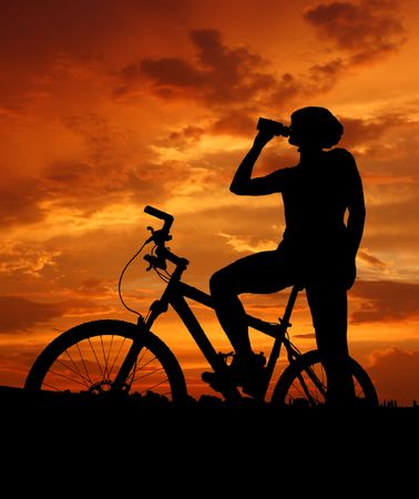 mountain biker silhouette in sunrise Stock Photo - 6522400