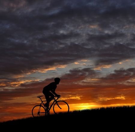 rapidity: Road cycler silhouette in sunrise  Stock Photo