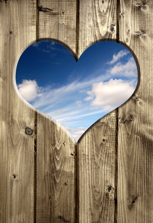 blue sky hole in a wooden wall background Stock Photo - 8277437