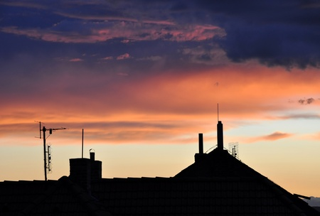 Sunset silhouettes of houses  photo