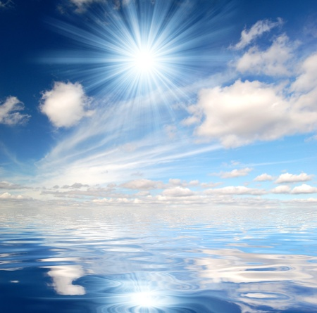sunrays: sunny sky above sea Stock Photo