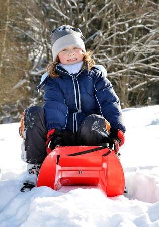 wintrily:  girl on a sleigh  Stock Photo