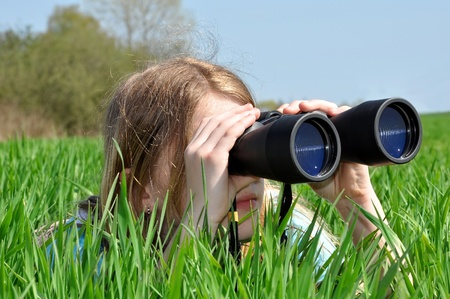 binocular: Girl looking through binoculars