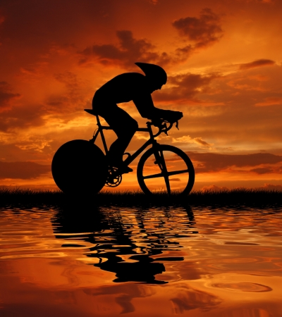 cycling: Road cycler silhouette in sunrise  Stock Photo