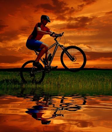 mountain biker silhouette in sunrise Stock Photo - 8689348