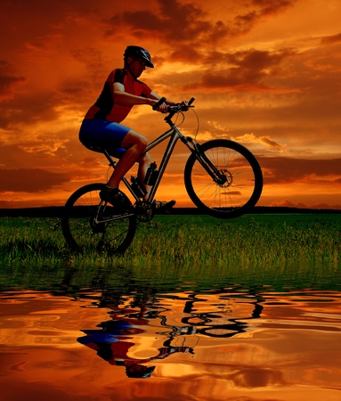 mountain biker silhouette in sunrise Stock Photo - 8689348