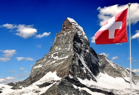 Beautiful mountain Matterhorn with Swiss flag - Swiss Alps photo