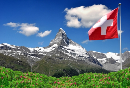 alps: Beautiful mountain Matterhorn with Swiss flag - Swiss Alps