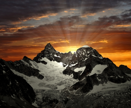 traditional climbing: sunrise on the Ober Gabelhorn - Swiss Alps Stock Photo