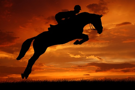 horse jumping: silhouette of a rider on a jumping horse