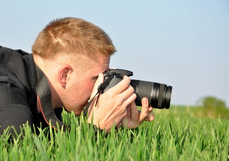 filming: photographer with SLR camera