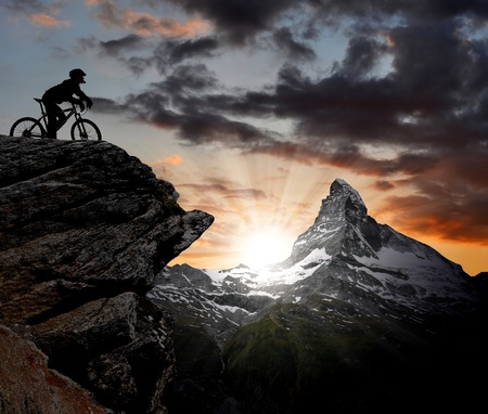 biker in the Swiss Alps  Stock Photo - 10226700