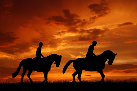 horse riders in the sunset  photo