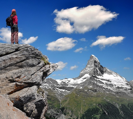 traditional climbing: girl looking at the beautiful Mount Matterhorn in the Swiss Alps  Stock Photo