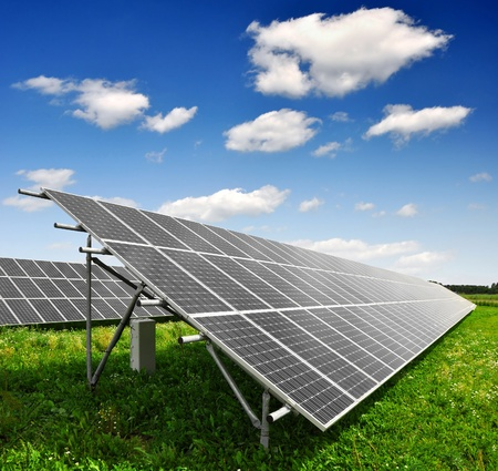 photovoltaic: Solar energy panels against blue sky with clouds