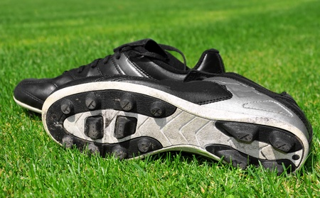 cleats: football shoes on a grass