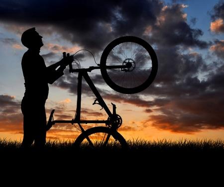 mountain biker silhouette in sunrise  photo