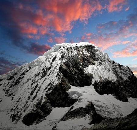 A summit in the Cordillera Blanca - Mountain Chopicalqui , Peru  photo