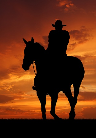 sunset clouds: Silhouette cowboy with horse in the sunset
